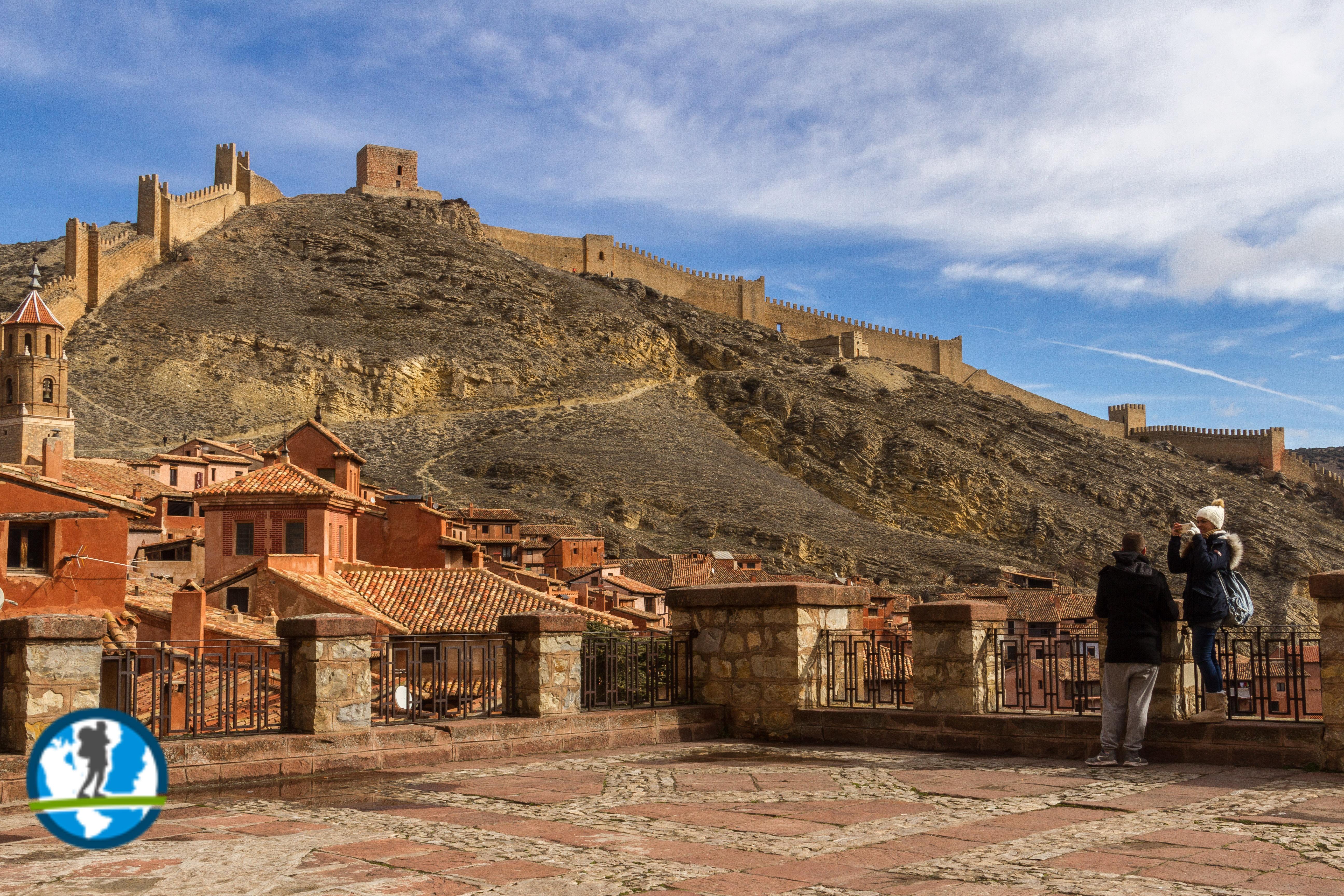 Picture of Albarracin with castle walls in the background.