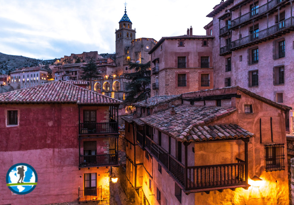 Night picture of Albarracin with town in the foreground and church tower in the background.